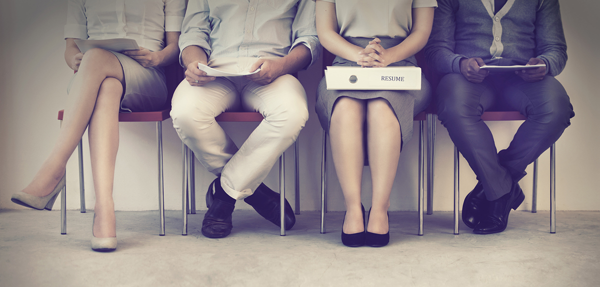 girl sits between two men waiting for a job interview