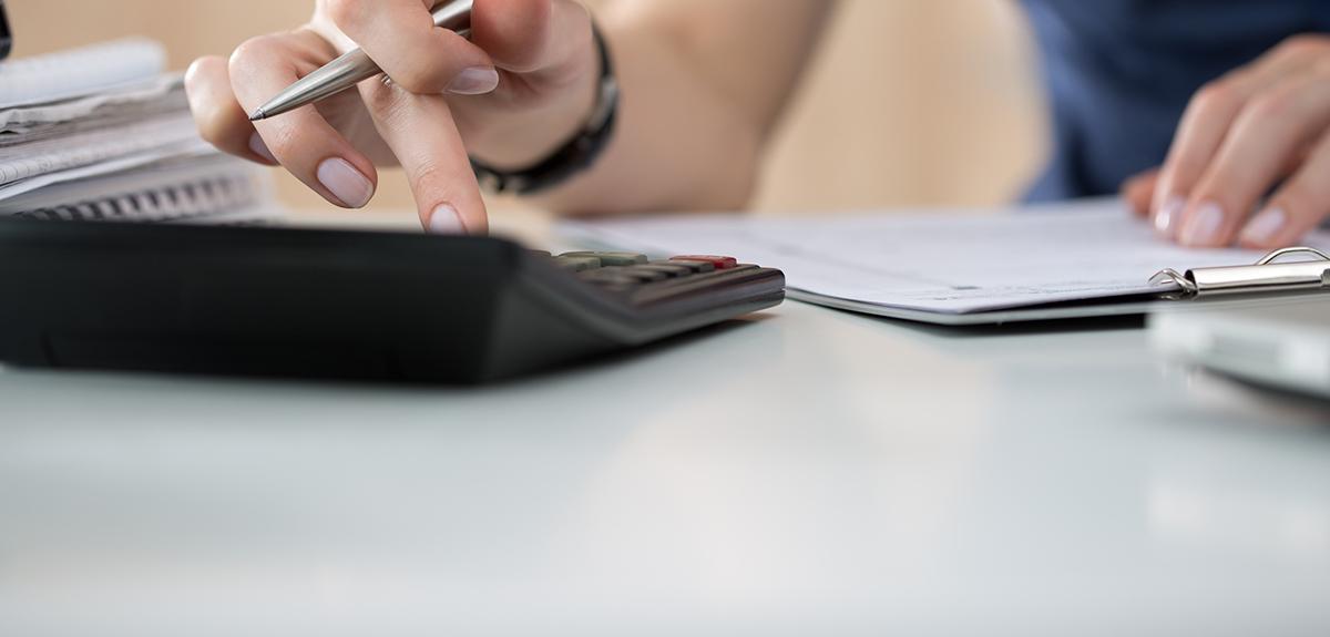 woman types on calculator