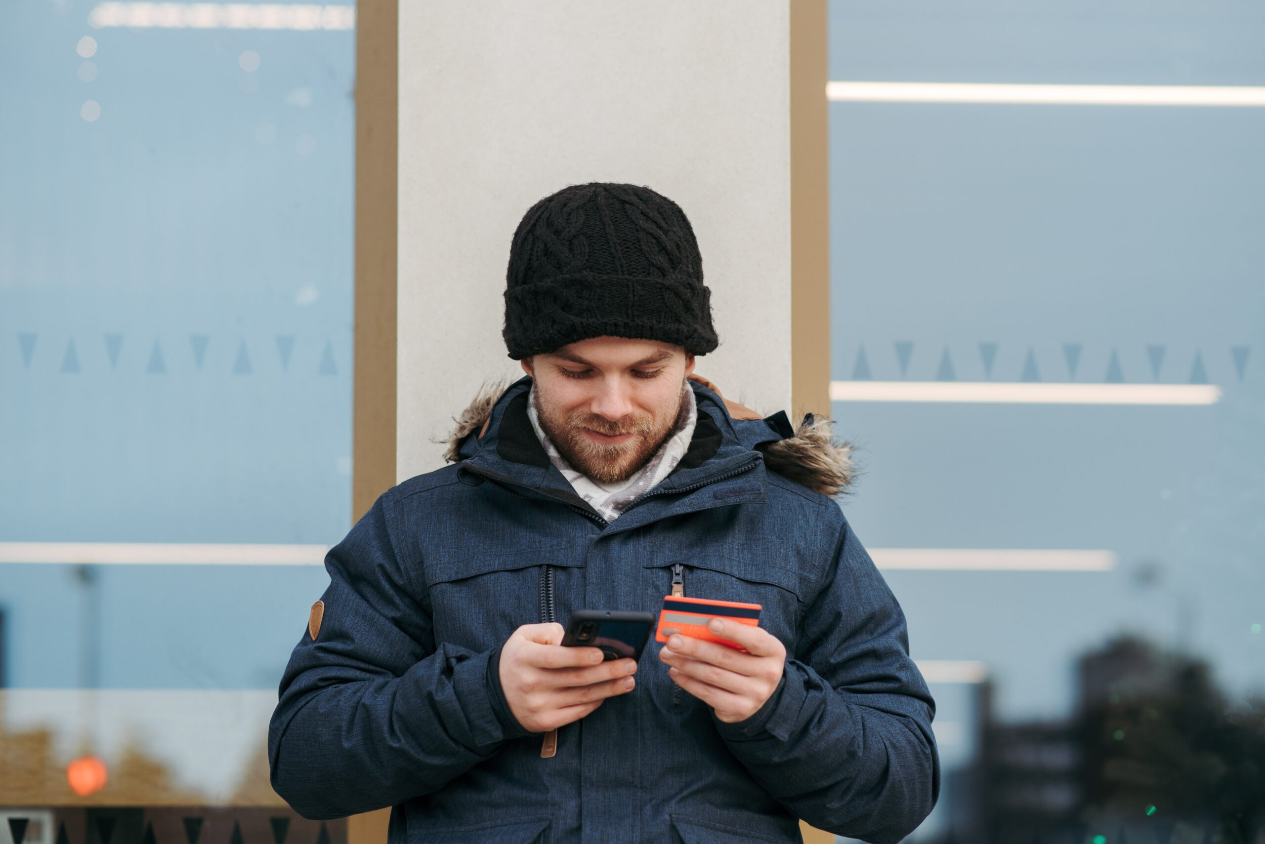 man on phone with credit card in hand